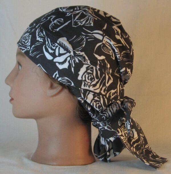 Hair Bag in White Outlined Roses on Black - left