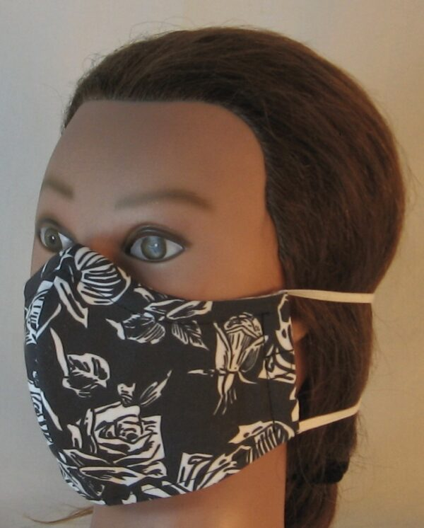 Face Mask in White Outlined Roses on Black - front left