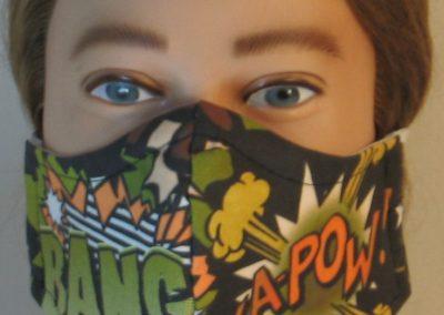 Face Mask in Bang Ka-Pow in Green Orange Black - front
