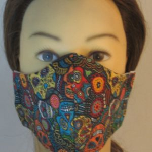 Face Mask in Sugar Skulls Flowers in Yellow Orange Green Red - front