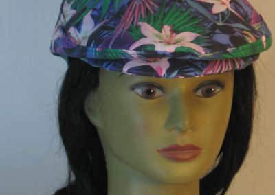 Ivy Flat Cap in Lily And Parrot With Mums at Dusk - front