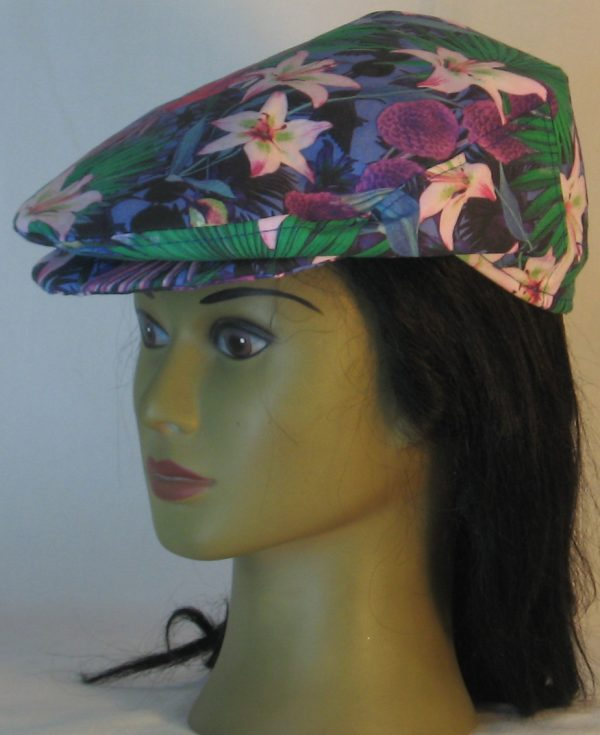 Ivy Flat Cap in Lily And Parrot With Mums at Dusk - left