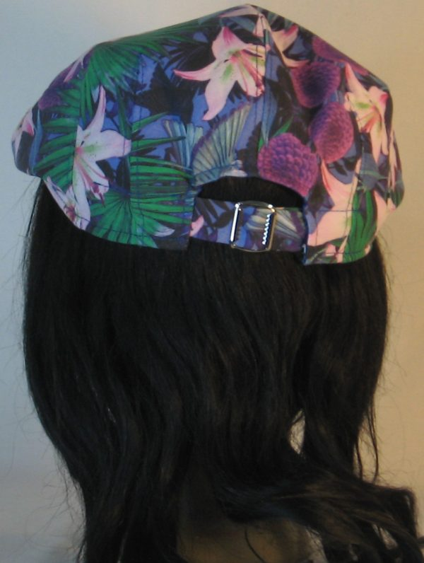 Ivy Flat Cap in Lily And Parrot With Mums at Dusk - back