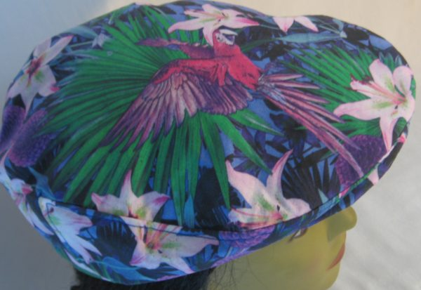 Ivy Flat Cap in Lily And Parrot With Mums at Dusk - top
