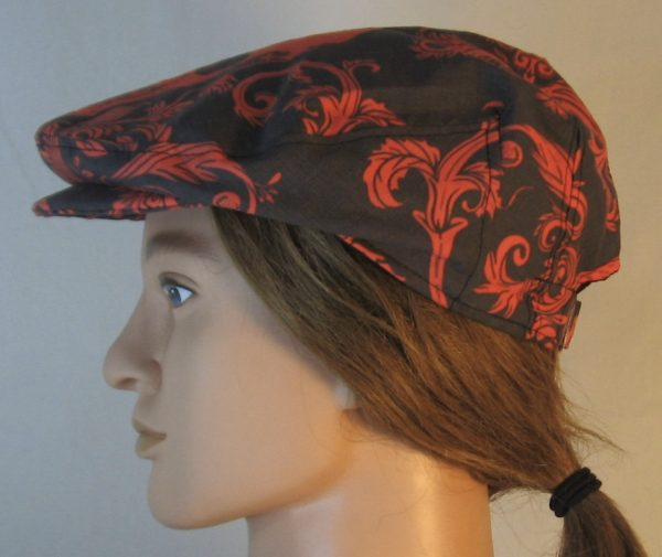 Ivy Flat Cap in Red Skull Scroll Leaves on Black Damask - left