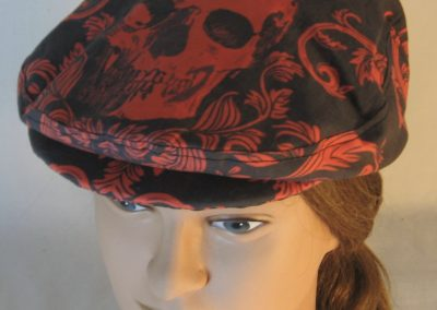 Ivy Flat Cap in Red Skull Scroll Leaves on Black Damask - top
