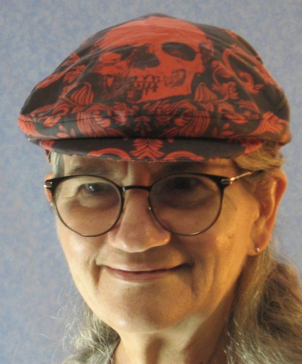 Ivy Flat Cap in Red Skull Scroll Leaves on Black Damask - model